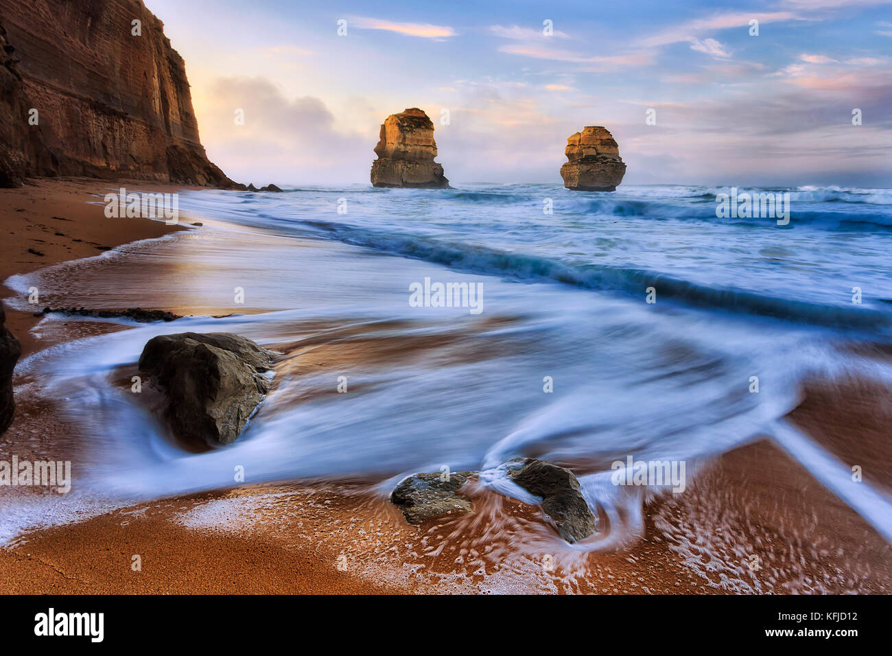Sunrise at Gibson steps beach on Great Ocean road twelve apostles marine park with view of two standing rocks disconnected - Stock Image