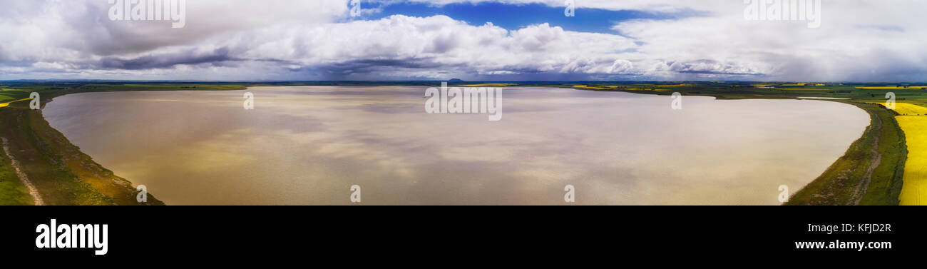 Shallow big flat hypersline lake Corangamite in elevated aerial panoramic view on a cloudy sunny day. Stock Photo