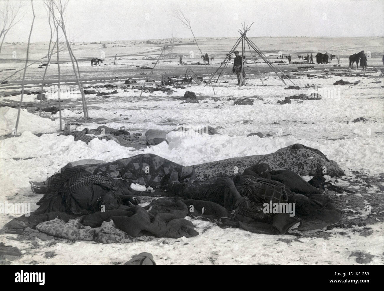 """""""Big Foot's camp three weeks after Wounded Knee Massacre; with bodies of four Lakota Sioux wrapped in blankets in Stock Photo"""