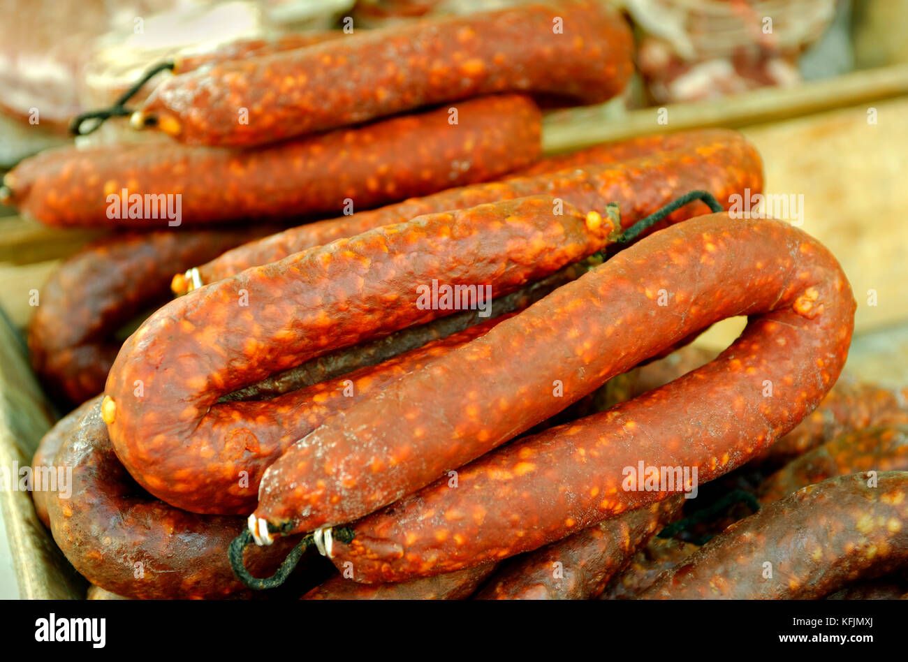Chorizo sausage for sale on a market stall - Stock Image