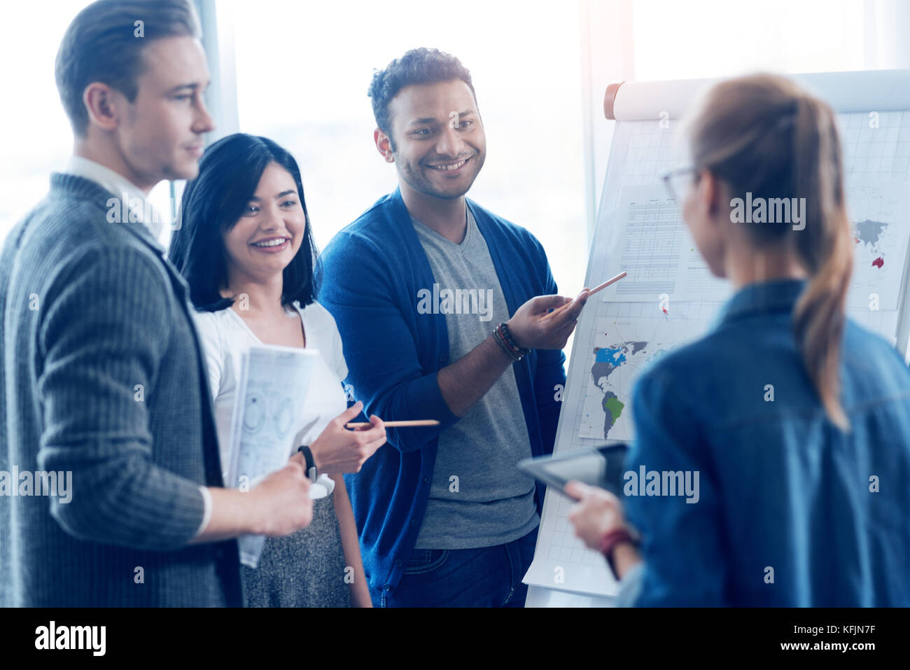 Group of positive people that listening their coworker - Stock Image