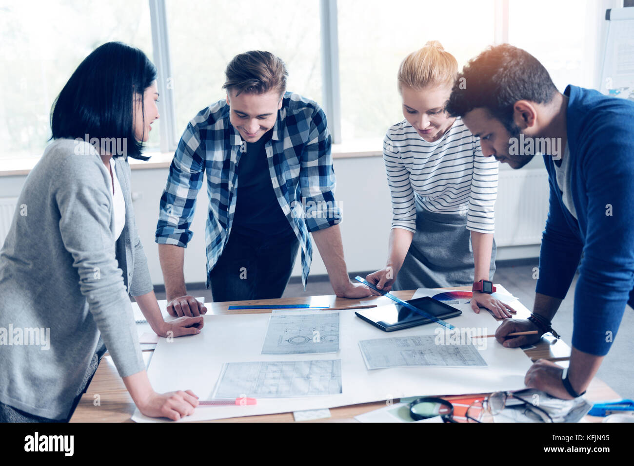 Attentive colleagues thinking about project - Stock Image