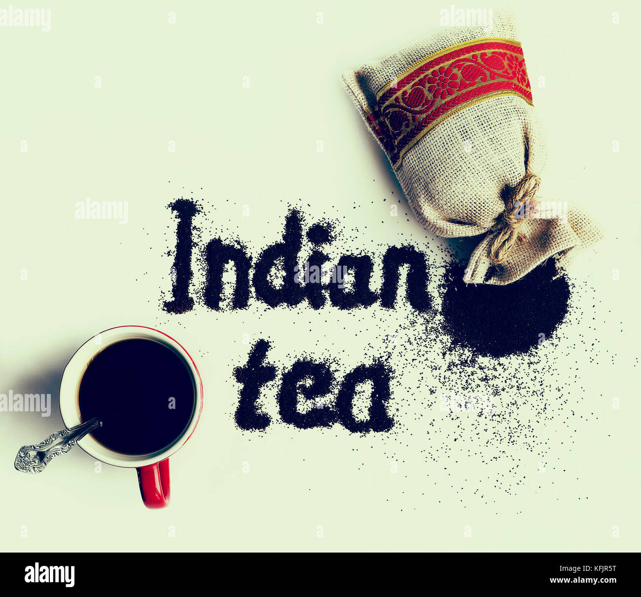 Inscription Indian Tea Next To The Mug And Packaging Of Granular Loose Black