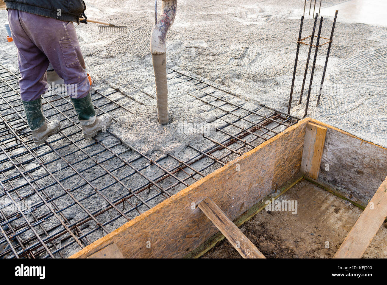pouring concrete slab - concrete pouring during commercial concreting floors of buildings in construction Stock Photo