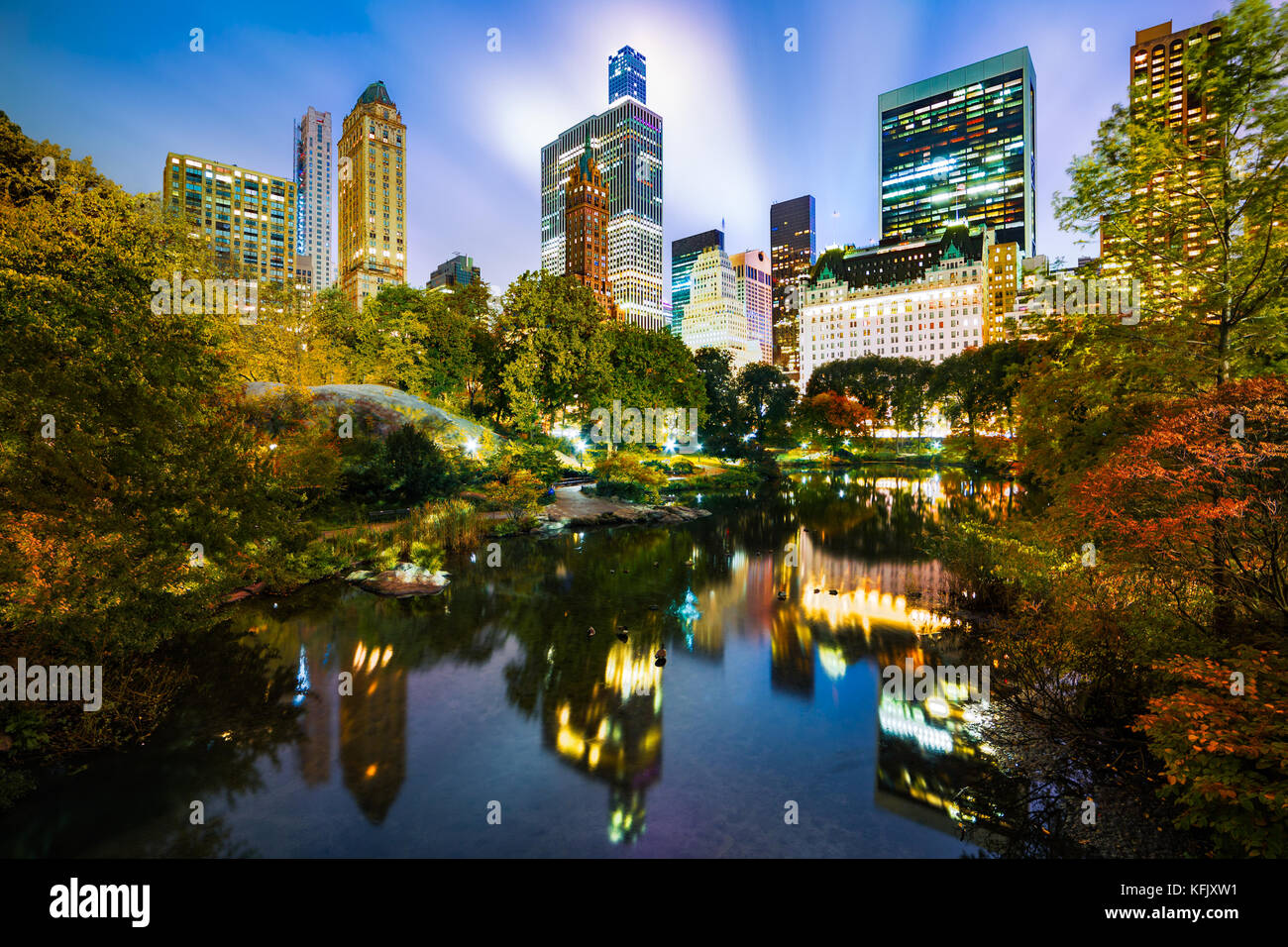 The Pond by night, as viewed from Gapstow Bridge in Central Park, New York City - Stock Image