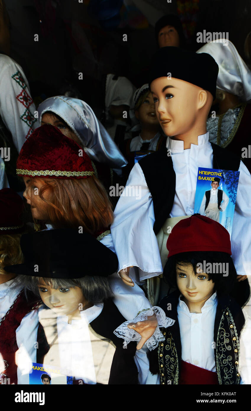A souvenir shop selling traditional Greek shirts and hats in