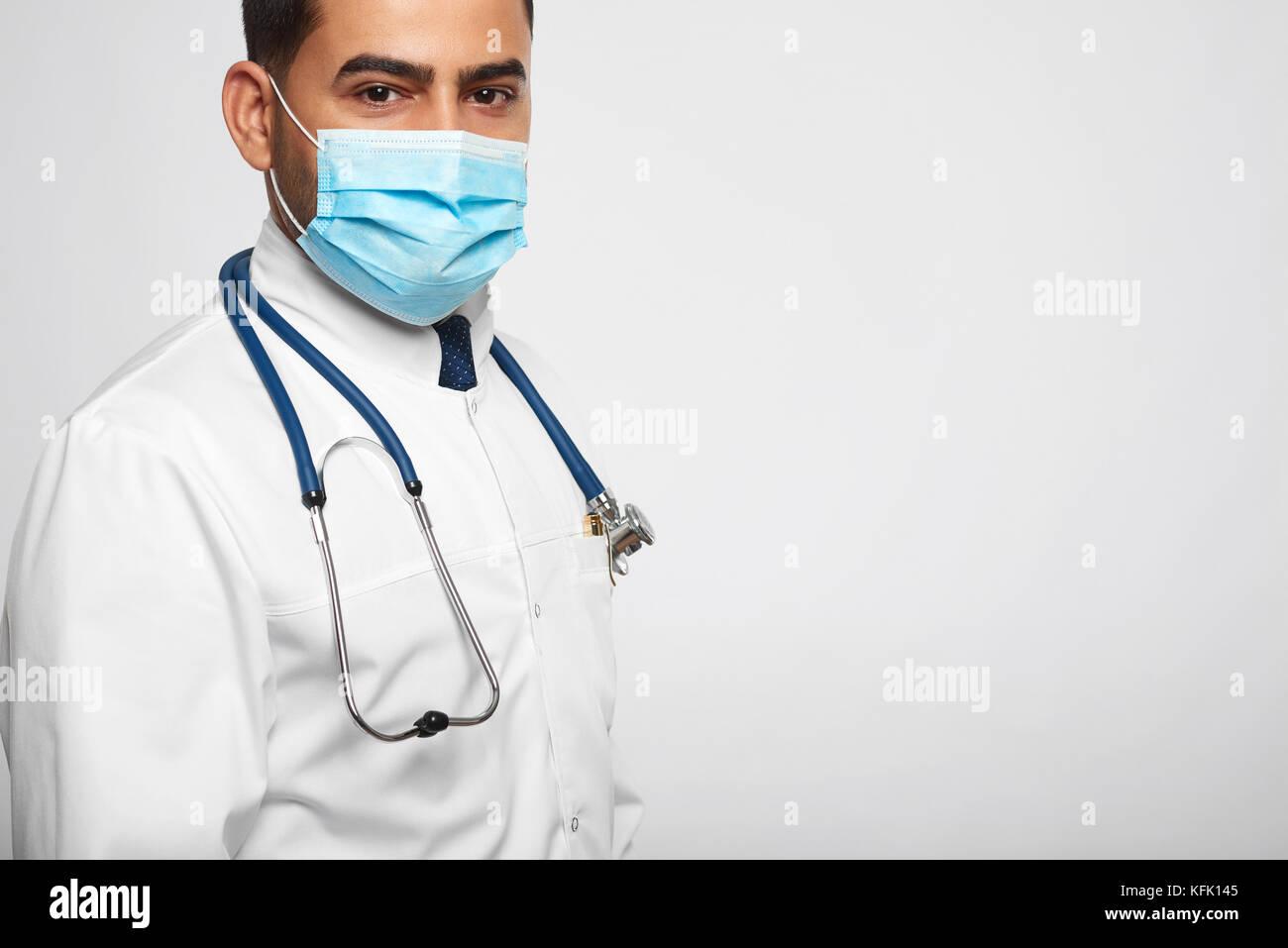 Male doctor posing at studio - Stock Image