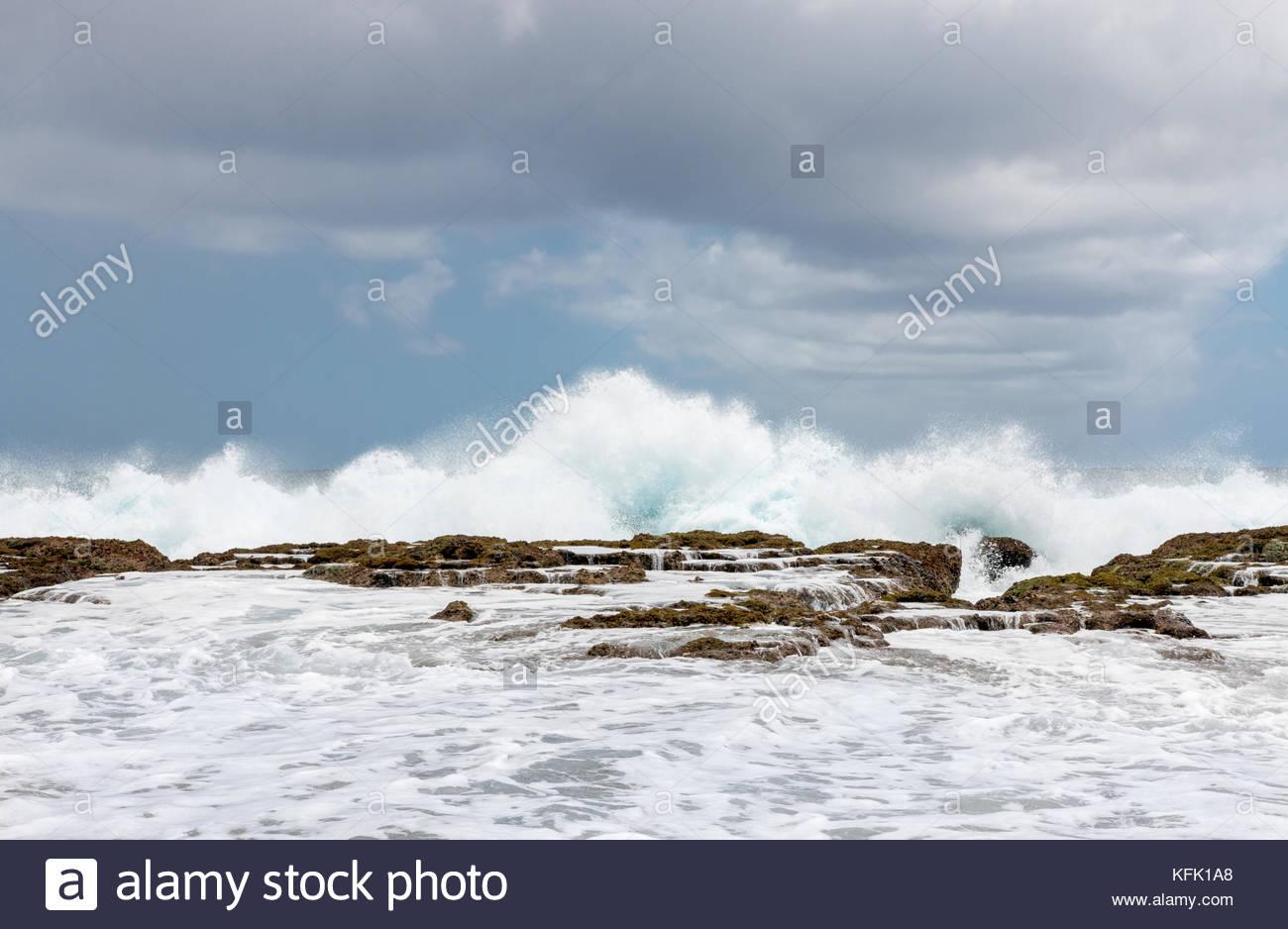 Waves crashing into the reef , Tongatapu island, Kingdom of Tonga - Stock Image