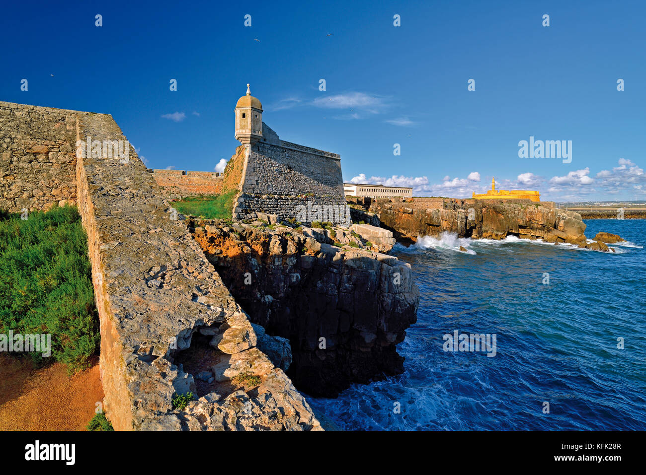 Coastline with medieval fortress and rocky coast in Peniche - Stock Image