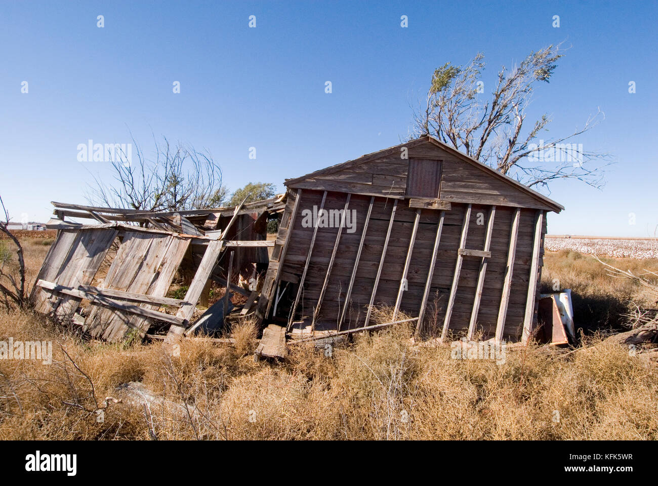 AN OLD DESERTED BARN IS ABOUT TO FALL DOWN WITH NEXT WINDSTORM - Stock Image