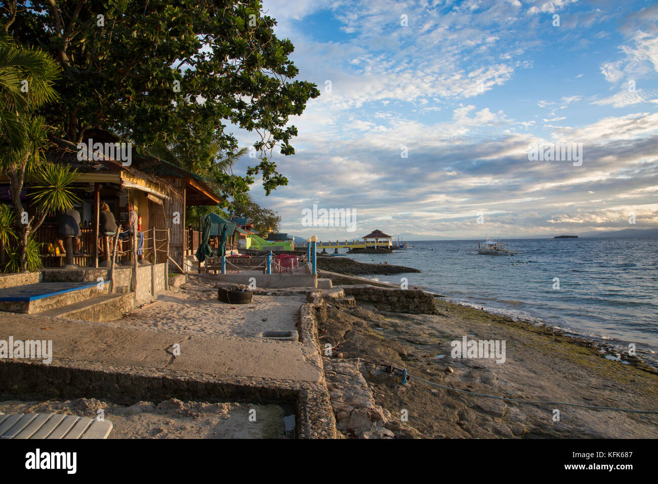 Scuba diving shops on rocky coastline in Moalboal, Cebu Island, Philippines - Stock Image
