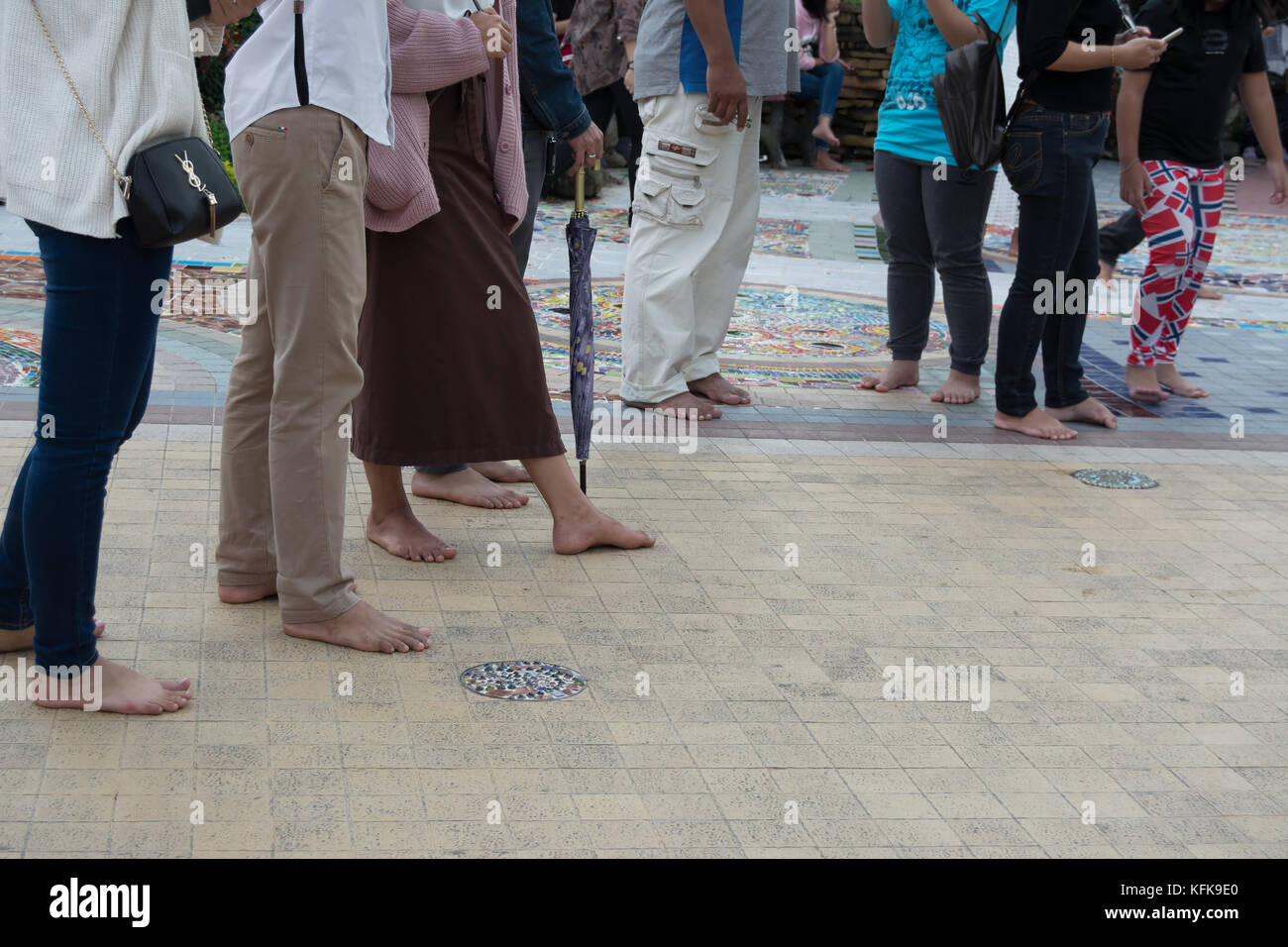 barefooted visitors to the temple, wat phra that pha kaew, in khao kho, thailand - Stock Image