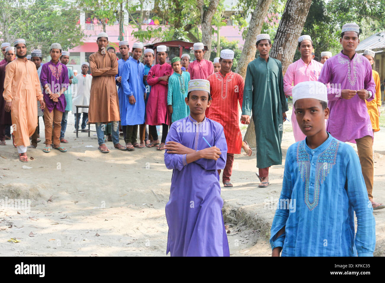 Schoolboys in colourful uniforms, Kalua, Chinni, Kurigram District, Bangladesh - Stock Image