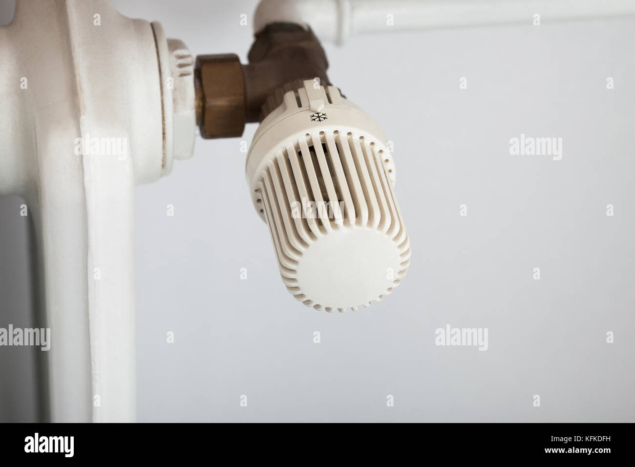 Closeup photo of temperature control on radiator - Stock Image