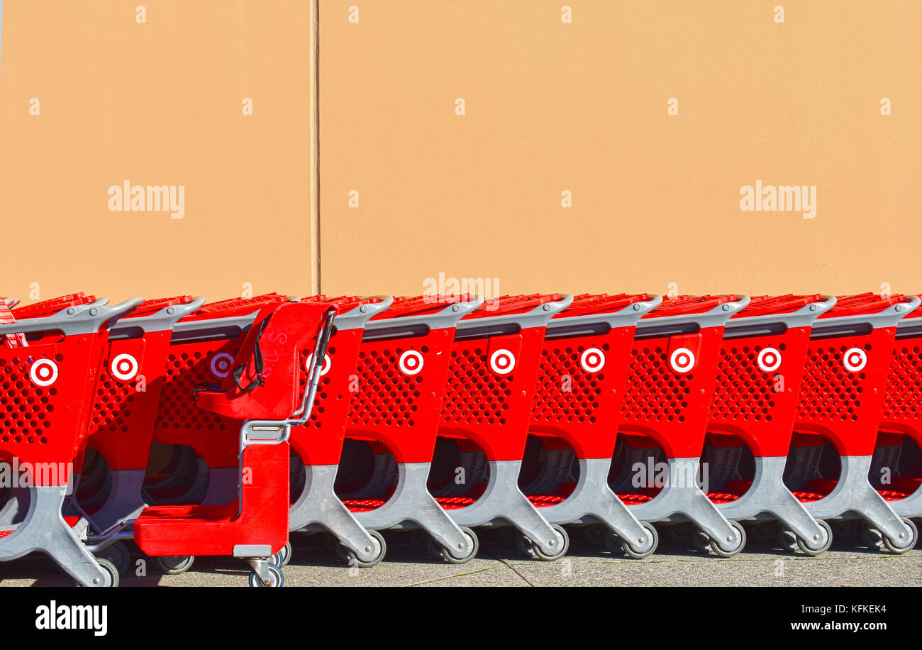 Target shopping carts lined up outside the store. - Stock Image