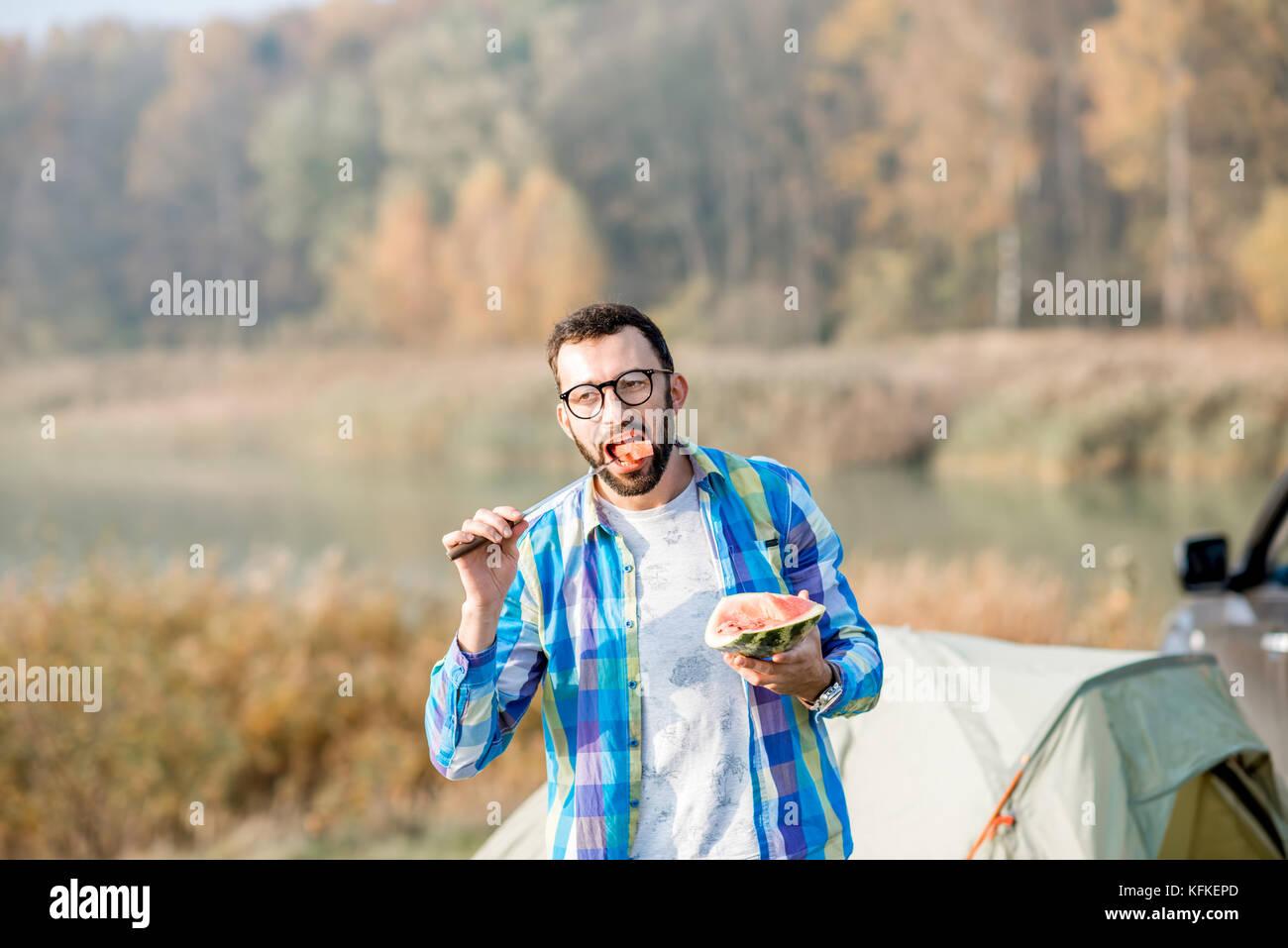 Man at the camping - Stock Image
