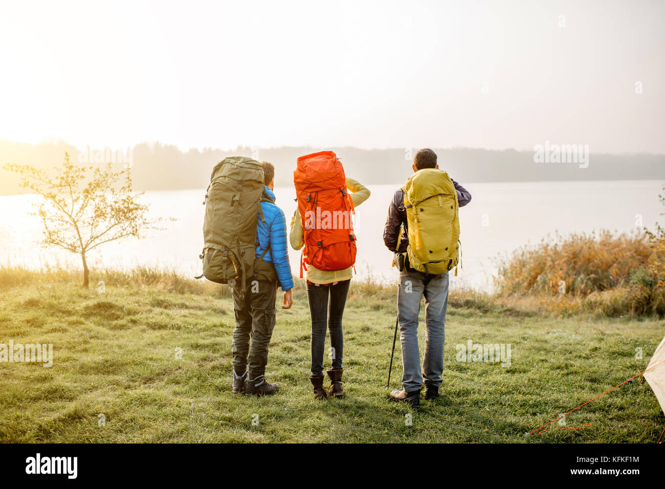 Hikers with backpacks outdoors - Stock Image