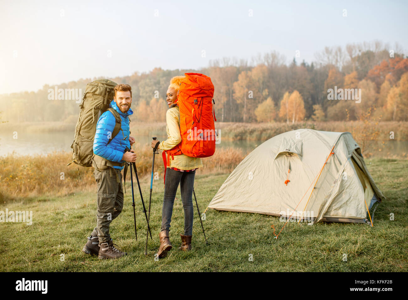 Couple hiking with backpacks - Stock Image