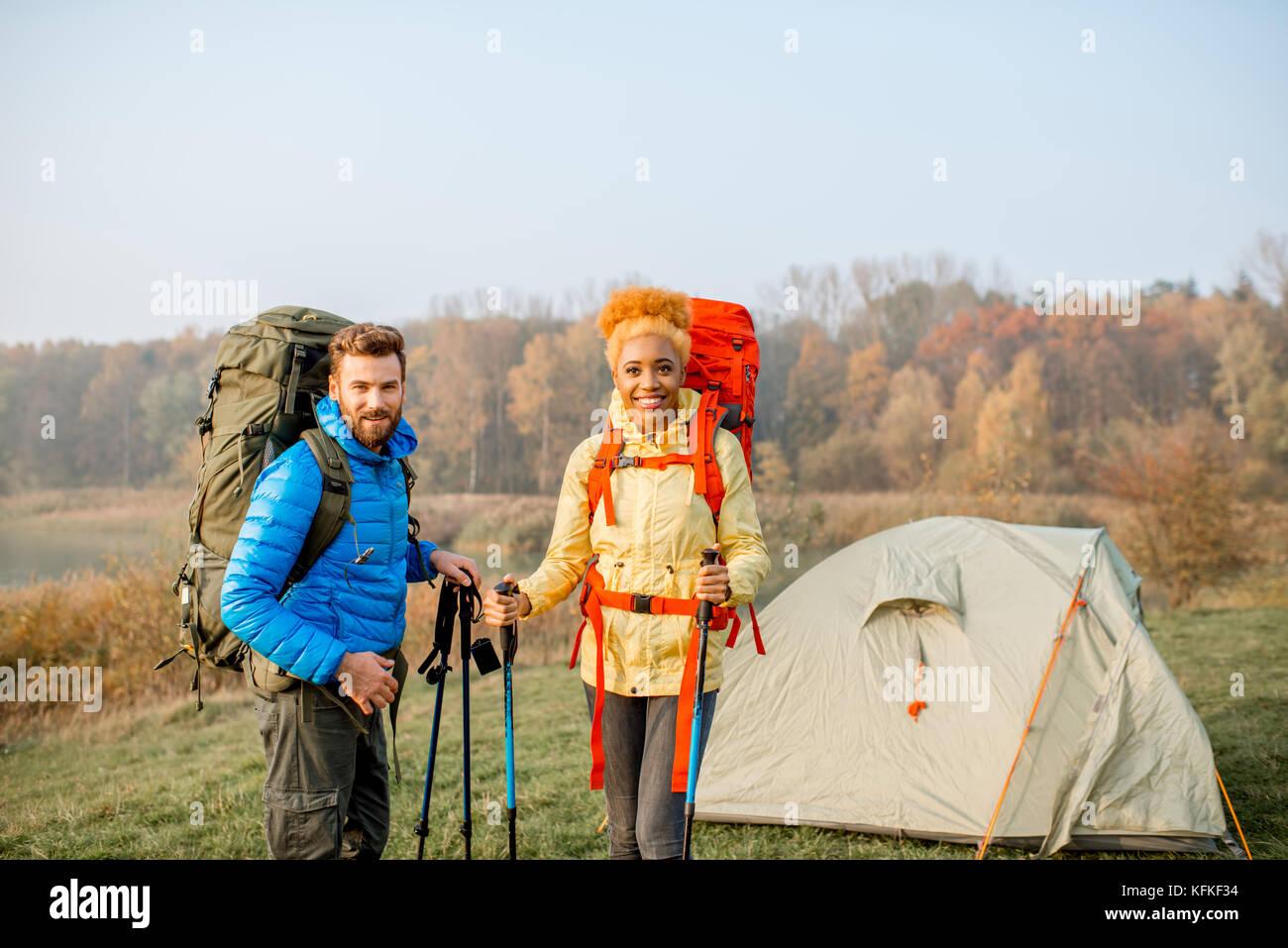 Couple hiking with backpacks - Stock Image