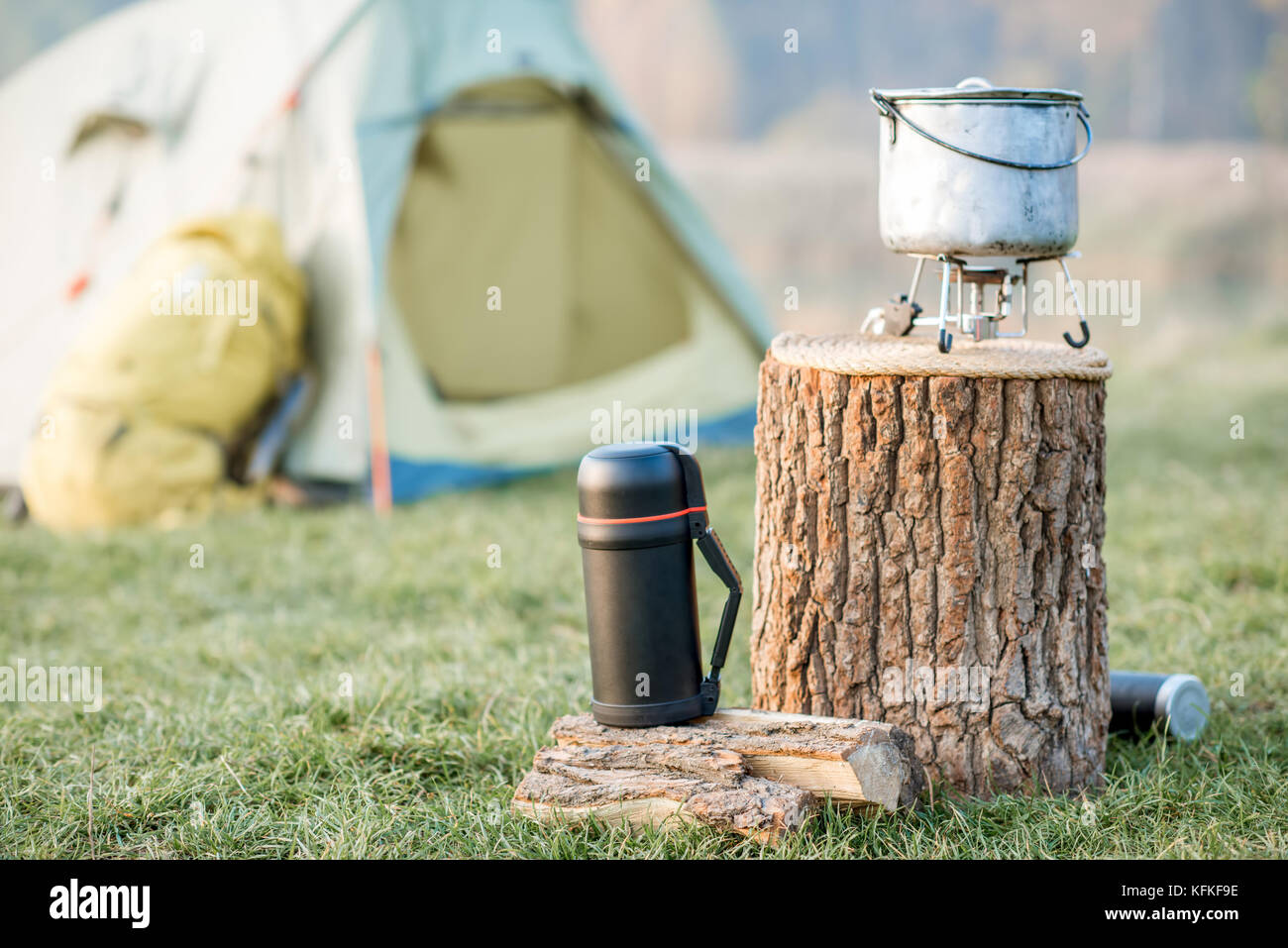 Camping place on the green lawn - Stock Image