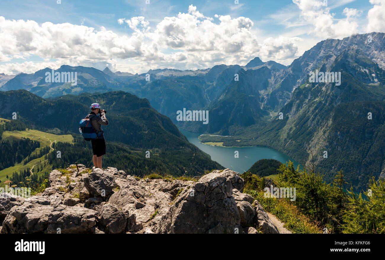 Man photographed, view over the Königsee from the Jenner, on the right Watzmann, Schönau am Königssee, - Stock Image