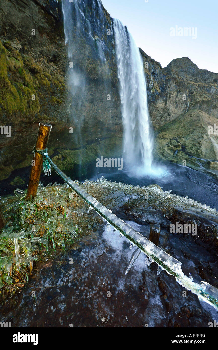 Eope and frass covered with ice, South Island, Island at Seljalandsfoss waterfall, South Island, Island - Stock Image