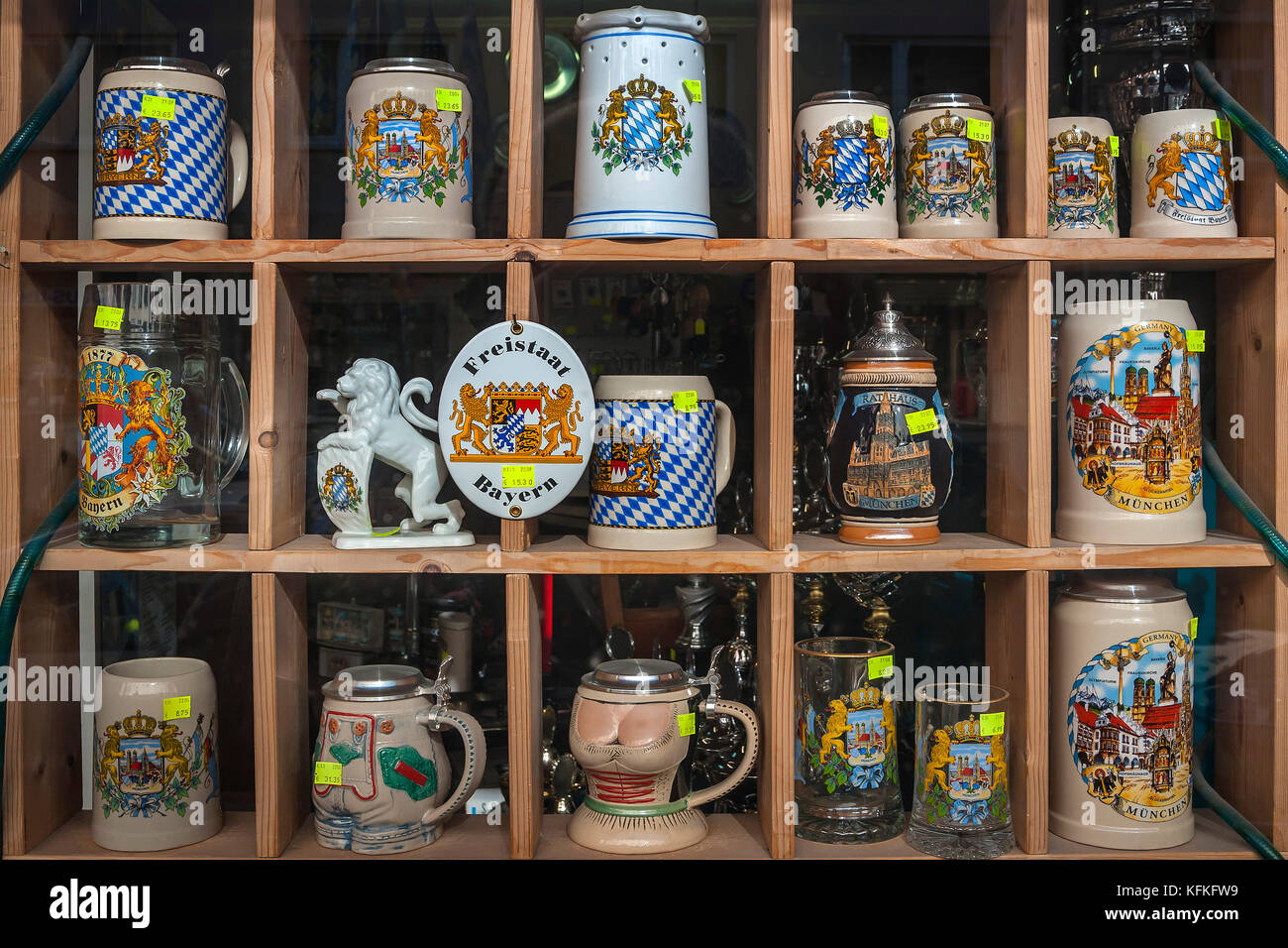 Various beer mugs with Bavarian motifs for sale, Munich, Upper Bavaria, Bavaria, Germany - Stock Image
