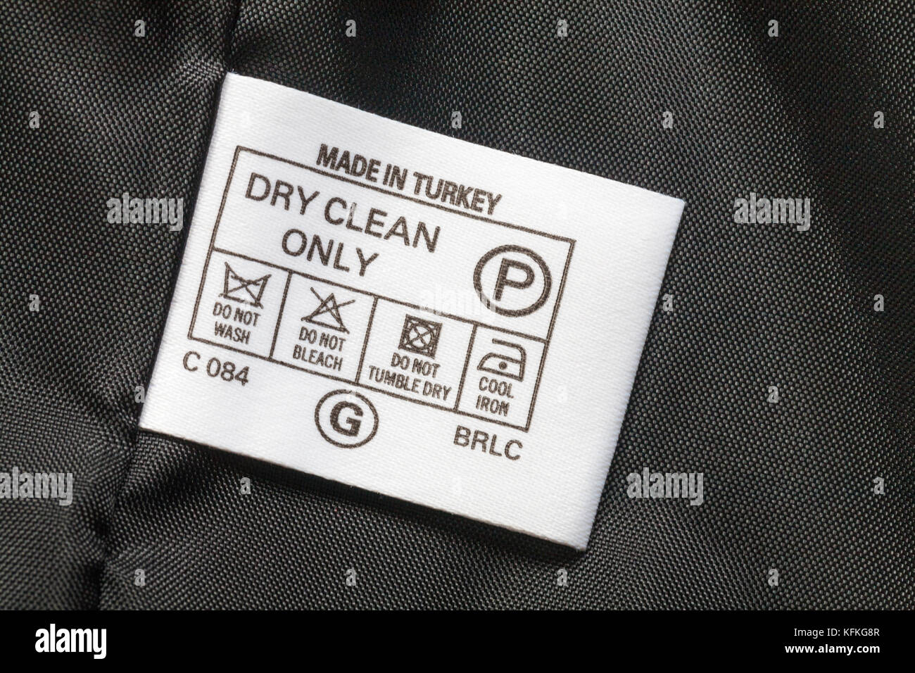 Washing symbols stock photos washing symbols stock images alamy washing care symbols dry clean only label in womans jacket made in turkey sold in biocorpaavc Choice Image