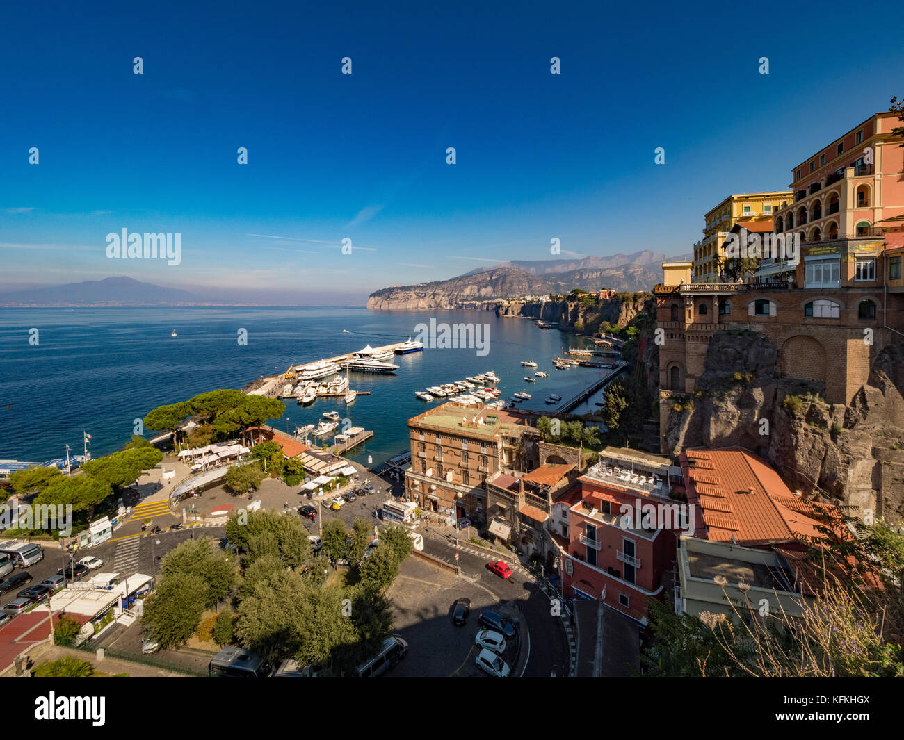 Moored boats in Marina Piccola, seen from an elevated view, with Mount Vesuvius  in the distance. Tyrrhenian Sea, - Stock Image