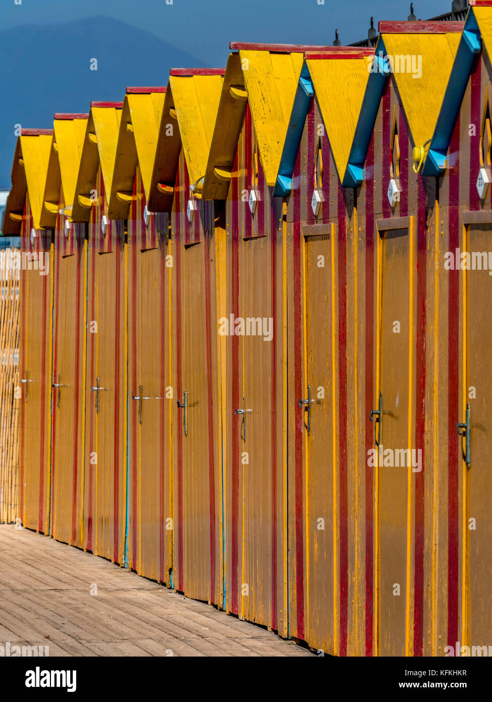 Yellow painted wooden bathing huts at Peter's Beach. A private beach in Sorrento. Italy Stock Photo
