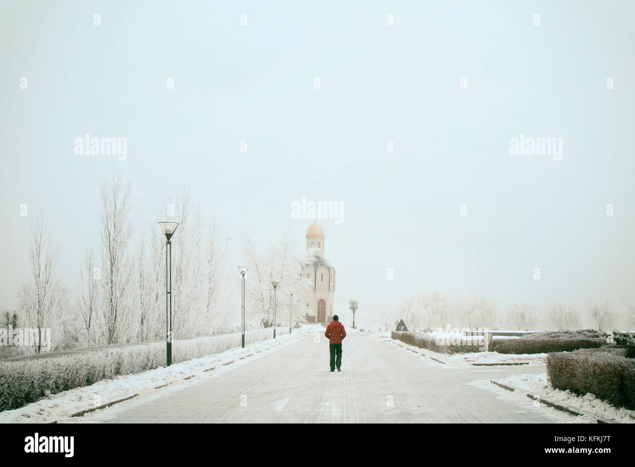 A passer-by on a winter snow-covered street - Stock Image