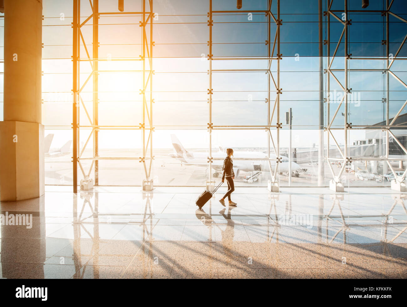 Woman at the airport - Stock Image
