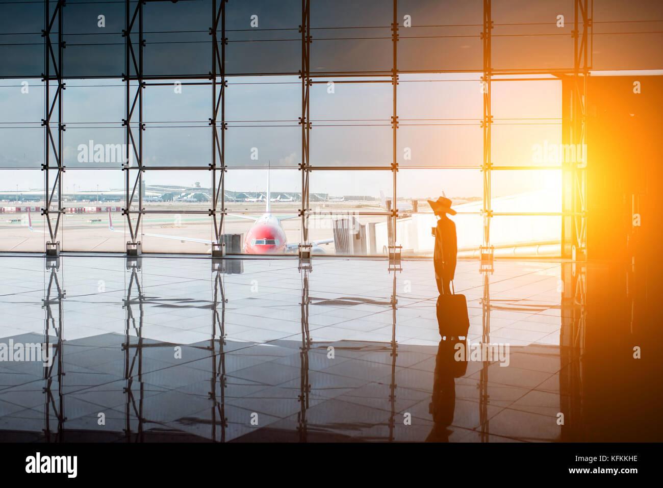 Woman near the airport window - Stock Image