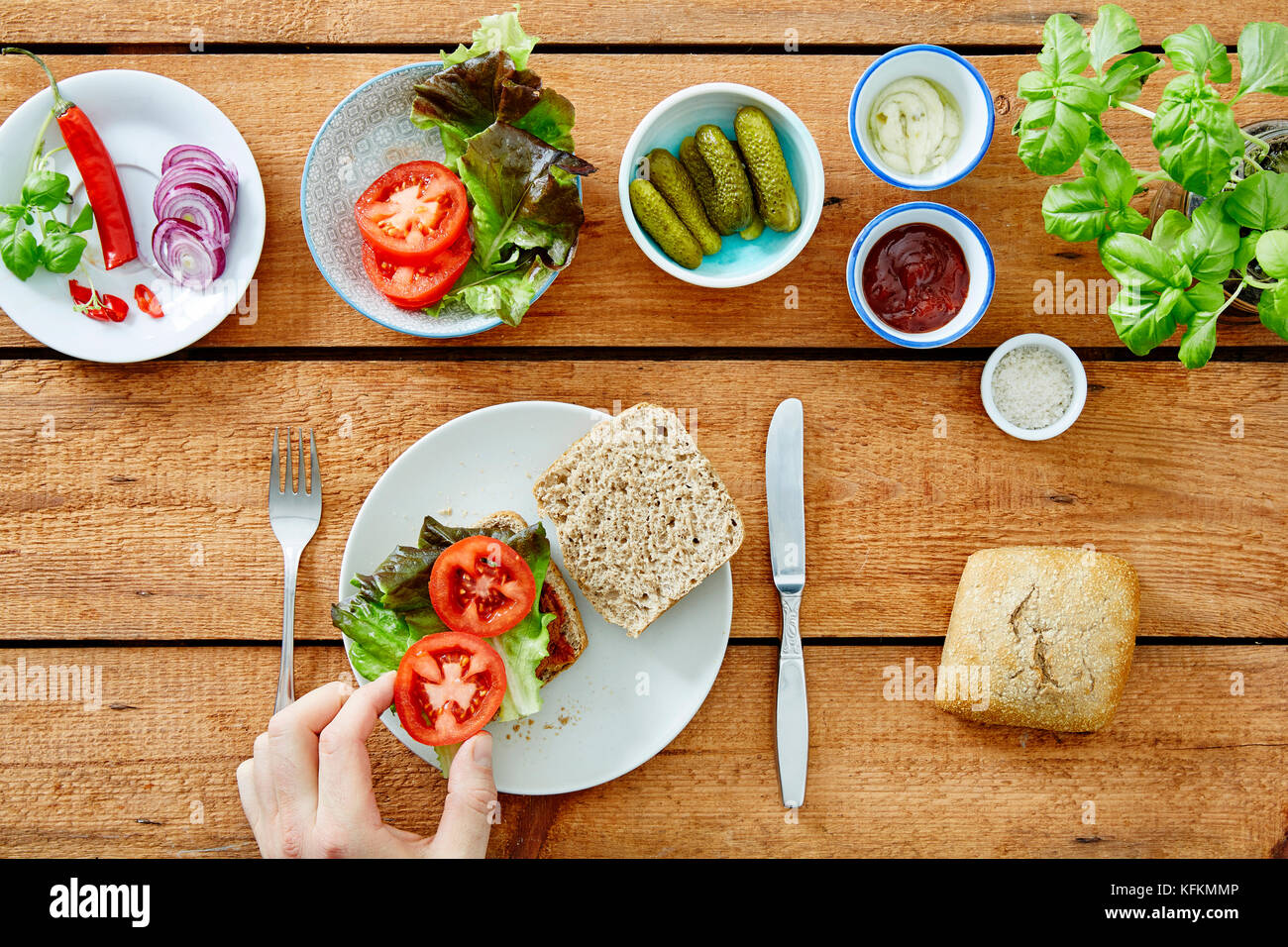 foodie preparing a fresh organic sandwich - Stock Image