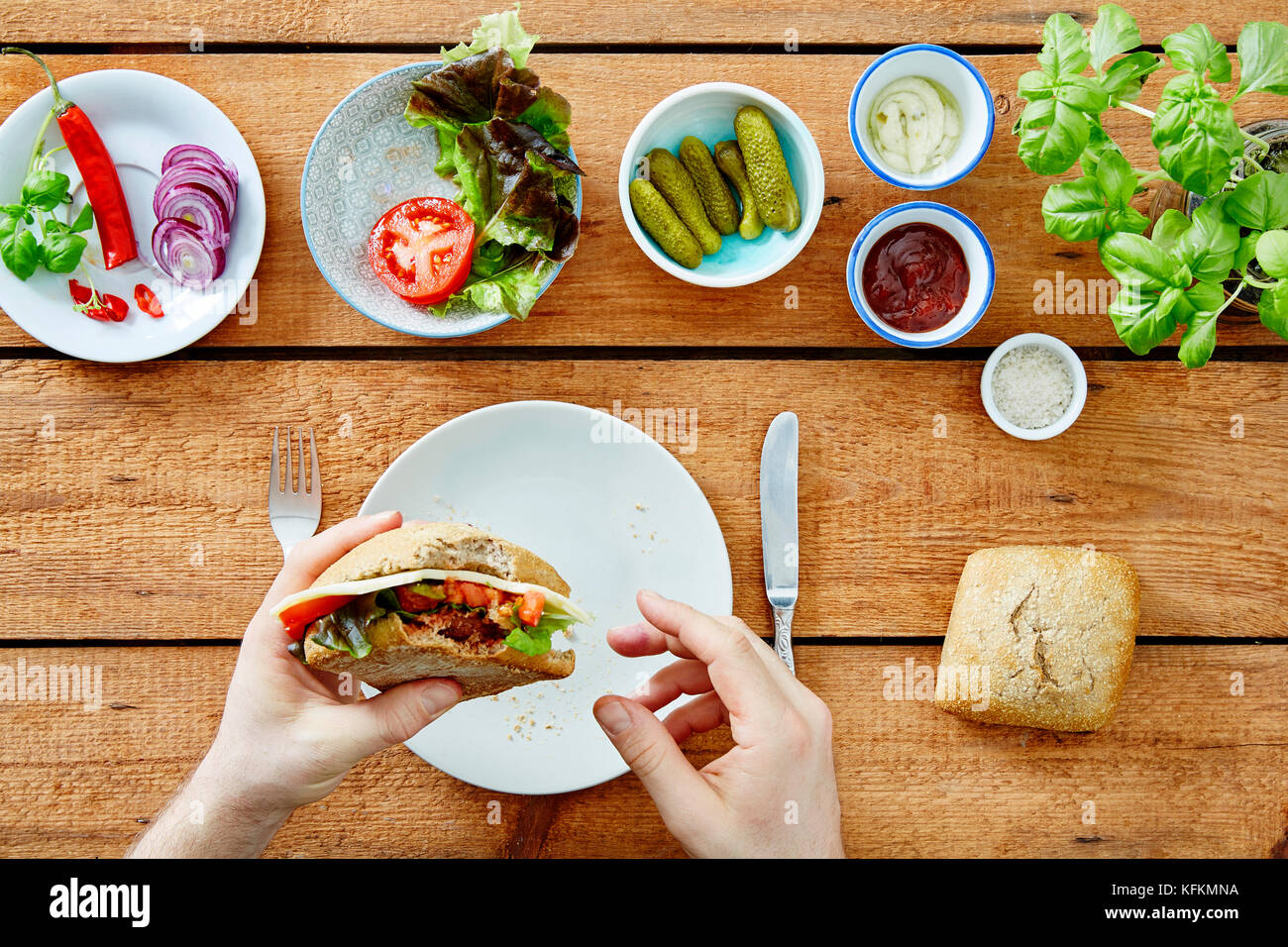 foodie eating self made delicious sandwich snack - Stock Image