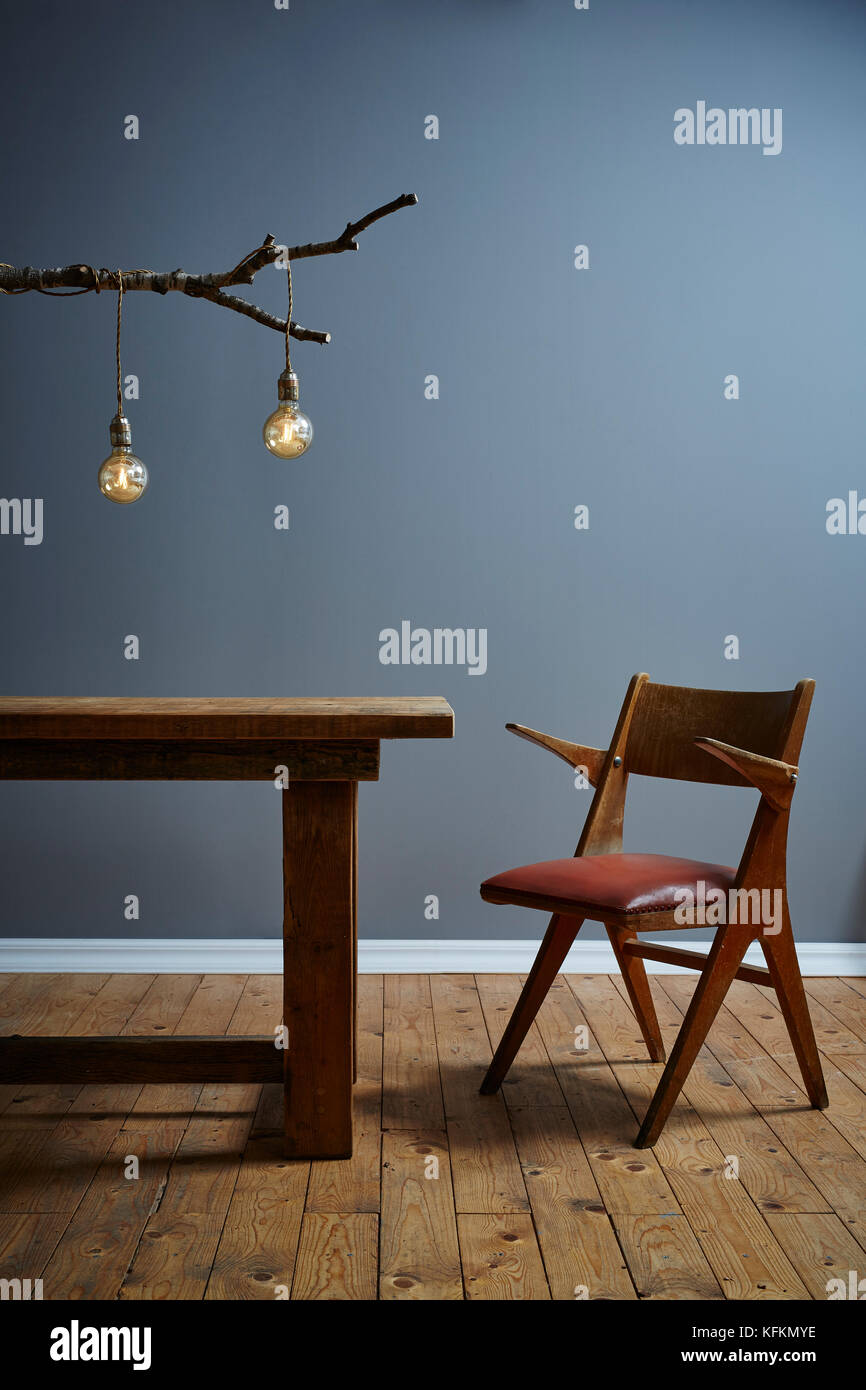 Modern Interior Wooden Table Branch Lamp And Chair   Stock Image