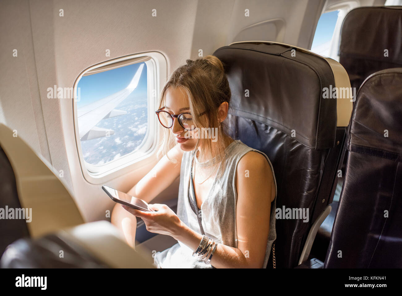 Woman in the airplane - Stock Image