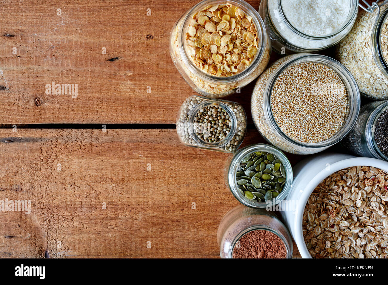 variety of mueslis in jars variety of healhty organic grains - Stock Image