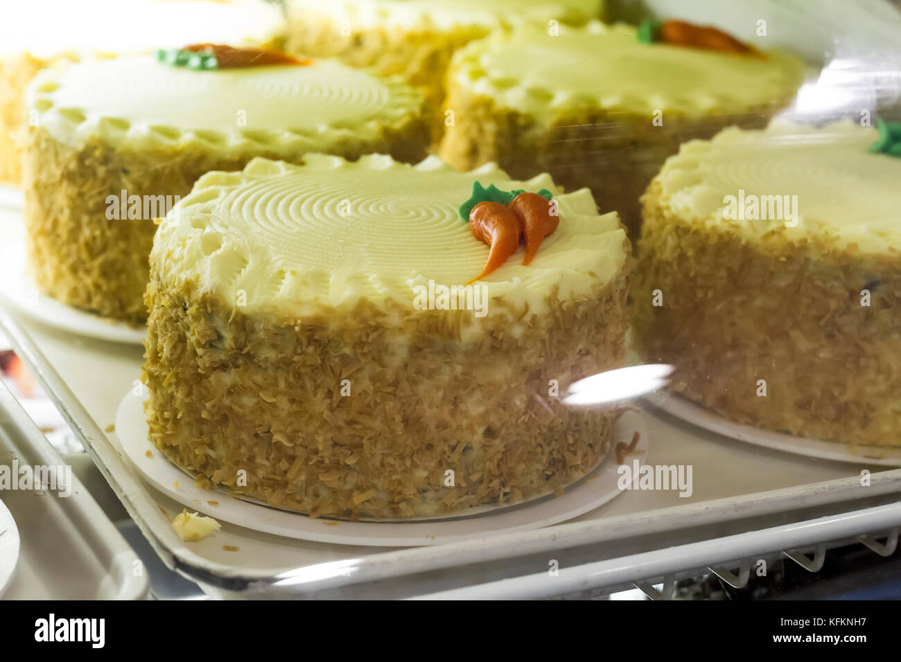 Carrot Cake Cupcake With Cream Cheese Frosting at a bakery. - Stock Image