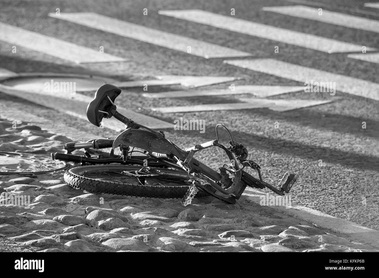 Crushed bike on the ground. Road accident  theme. Black and white photo - Stock Image