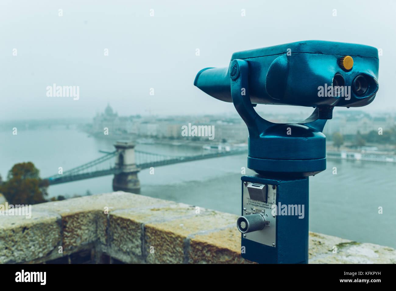 Binocular against observation deck view. - Stock Image