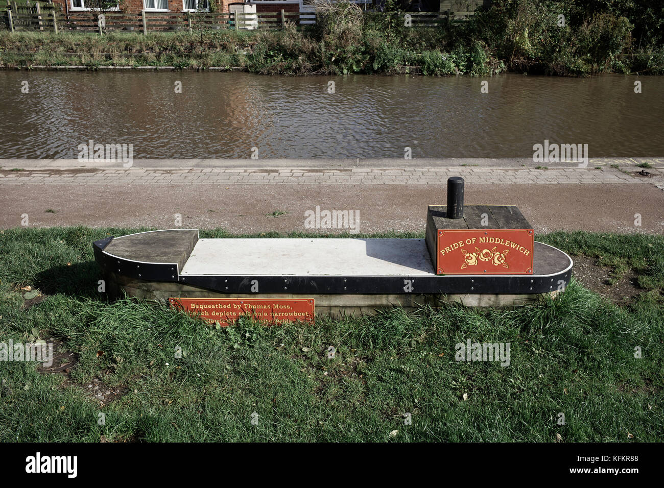 Canalside seat in the shape of a narrowboat - Stock Image