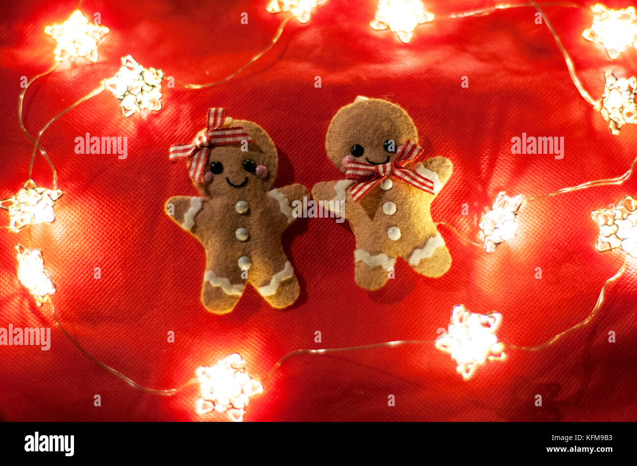 christmas gingerbread men decorations surrounded by fairy lights stock image