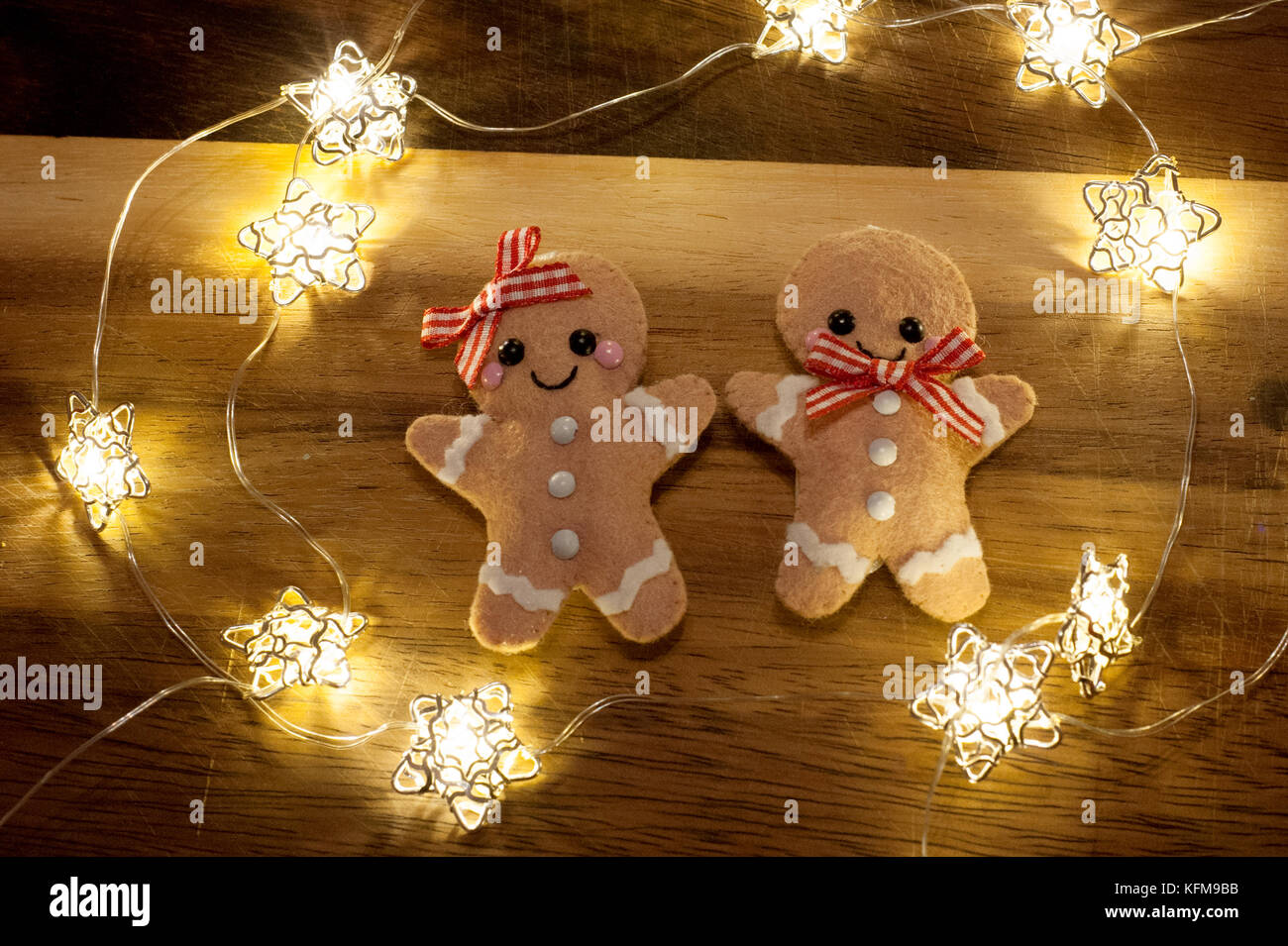 christmas gingerbread men decorations surrounded by fairy lights