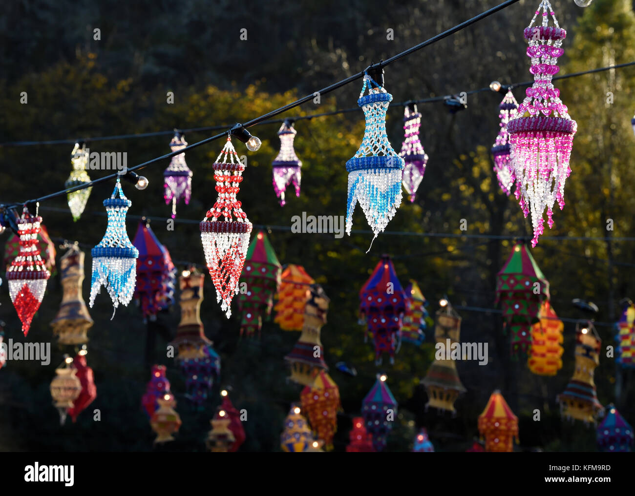 Coloured lanterns hang up in Princes Street Gardens, Edinburgh during the annual Diwali celebrations. - Stock Image