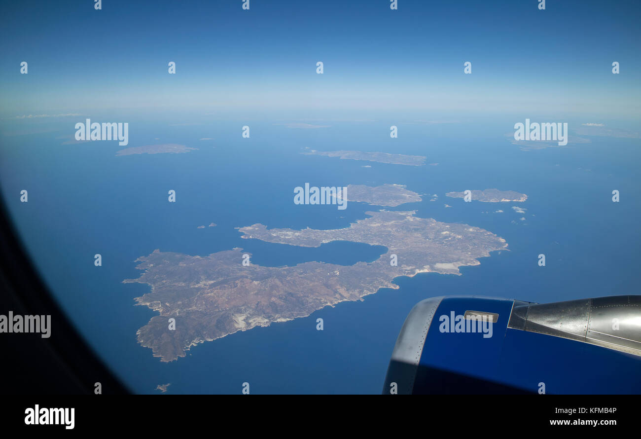 Greek island of Milos in the Cyclades group of islands seen from a passenger jet at 36,000 feet above. October 2017 Stock Photo