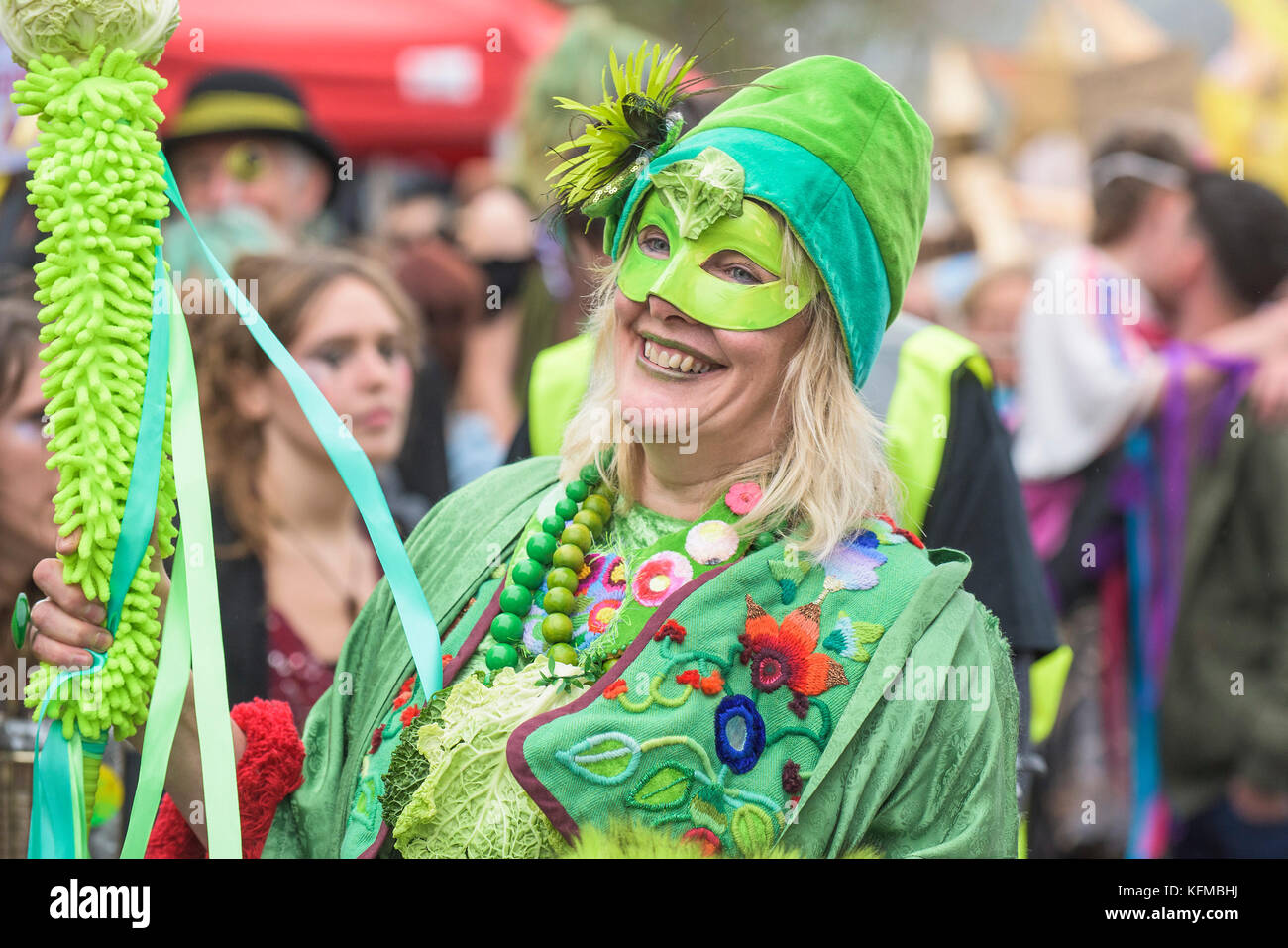 Penryn Kemeneth a two day heritage festival at Penryn Cornwall - a masked participant enjoying herself as she parades - Stock Image