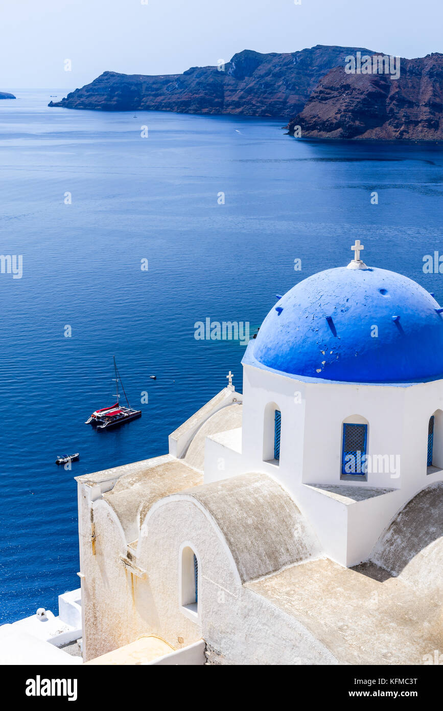 Oia, Santorini - Greece. Famous attraction of white village with cobbled streets, Greek Cyclades Islands, Aegean - Stock Image