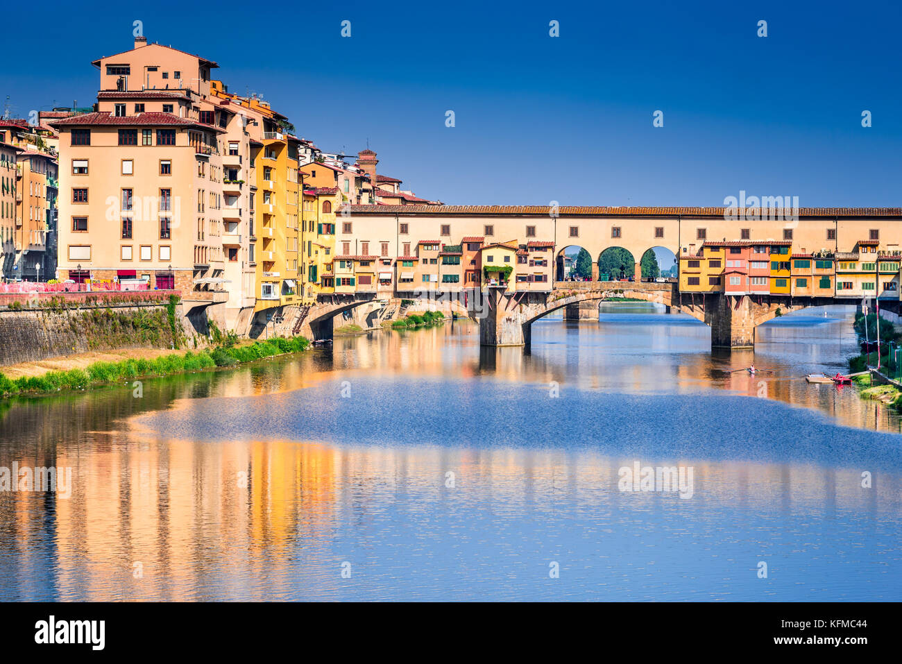 Florence, Tuscany - Ponte Vecchio, medieval bridge sunlighted over Arno River, Italy. - Stock Image