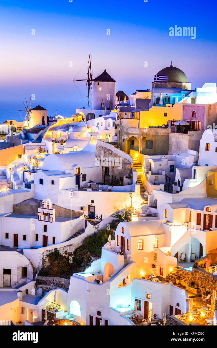 Oia, Santorini - Greece. Idyllic attraction of white village with cobbled streets and windmills, Greek Islands of - Stock Image
